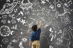 Kid-drawing-on-blackboard.jpg